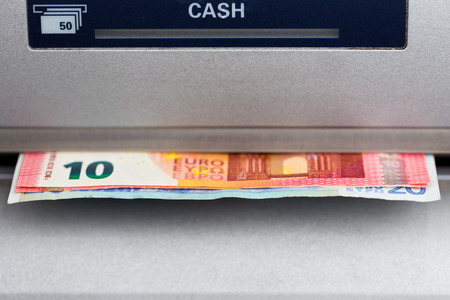 monies: Ten and Twenty Euro banknotes dispensed from an ATM in Europe