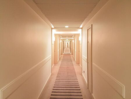 brightly lit: Brightly lit hallway typical for hotels and hostels Stock Photo