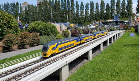 The Hague - July 16, 2019: Madurodam open air museum is located at the George Maduroplein in Den Haag and showcases The Netherlands in miniature. In this image a train from the Nederlandse Spoorwegen. 報道画像