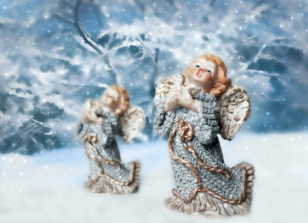 figurines: Two Christmas angels with trees and snow