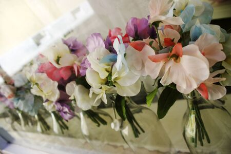 featured: Fake flowers fabric featured in glass bottles
