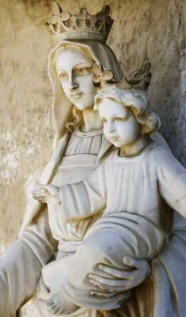 Statue of the Virgin Mary who is holding baby Jesus photo