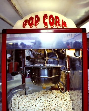 A popcorn machine with the sign light