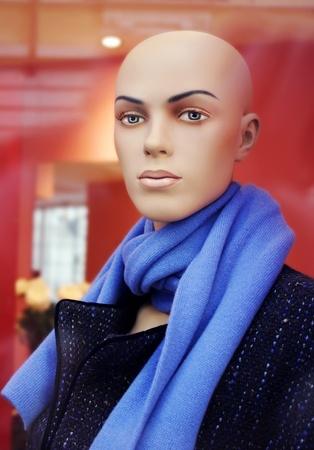 A female bald head dummy in the window photo