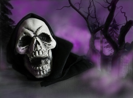 Halloween skull in a graveyard surrounded by fog photo