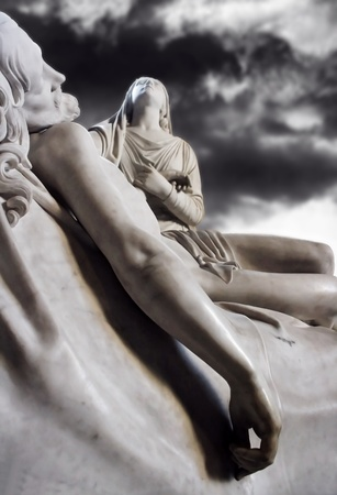 A beautiful marble statue representing the deposition of Christ with the Virgin Mary with a dramatic sky