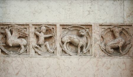 Medieval marble bas-relief representing mythological animals and an archer Stock Photo - 11274413