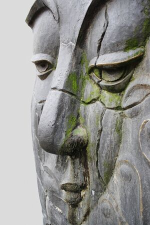 Face detail of a beautiful sculpture carved in stone representing Buddha Stock Photo - 11724310