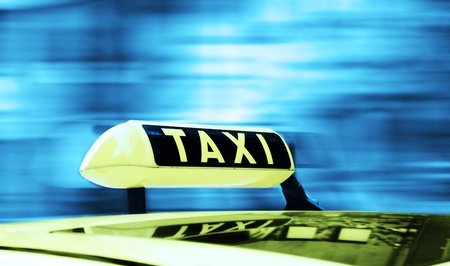 yellow taxi: Taxi sign in a motion background