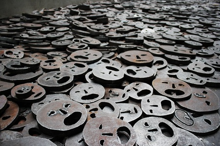 Schalechet (Fallen Leaves) by Menashe Kadishman. Installation of 10,000 open mouthed faces at the Jewish Museum, Berlin. Photo taken on December 7th 2011