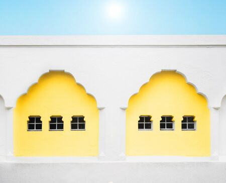 Details of a facade of an arabian house with sky and sun Stock Photo - 11967431