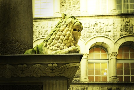 Detail of a beautiful decorative statue representing a lion lying down on the ledge Stock Photo - 12044356