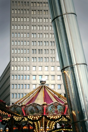 Photo detail of an urban architectonical mix with a carousel Stock Photo - 12044363