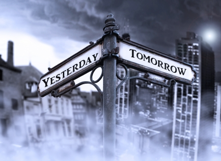 Arrows indicates Yersterday and Tomorrow with two different dramatic view: old and new city wrapped in fog in the background Stock Photo