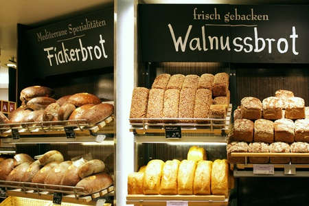 Different types of rustic bread display in a German bakery