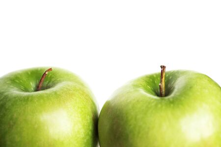 Photo detail of two green apples on the white background Stock Photo - 12177592