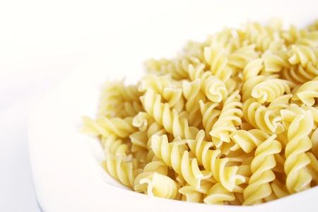 twists: pasta twists, fusilli, in a white plate Stock Photo