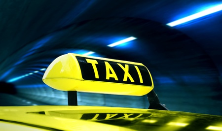 Yellow Taxi in a tunnel at night Stock Photo
