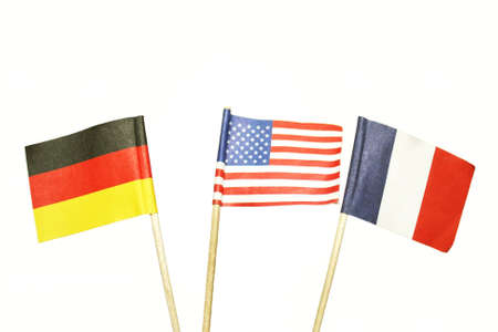 German, American, French miniature flags on white background Stock Photo - 12544787