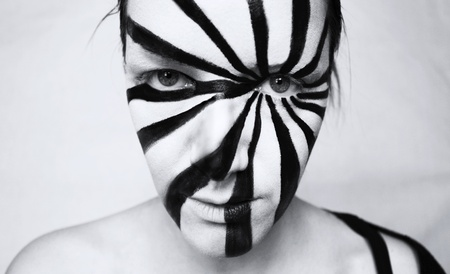 futuristic woman: Black and white portrait of a nice young girl with an optical art make up Stock Photo