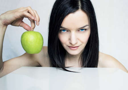 Photo of a beautiful attractive young woman with a green apple  Stock Photo - 12723535