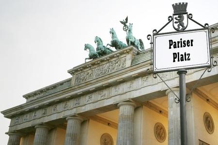Brandenburg Gate and the road sign indicate Pariser Platz. Stock Photo - 13069996