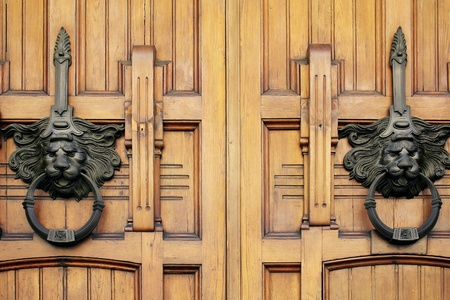 Detail of two handles of doorway of a building photo
