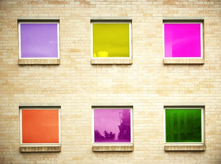 detail of a modern facade with six windows with different colors