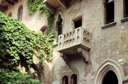 The famous antique facade of the building with the balcony of Juliet Capulet in Verona, Italy