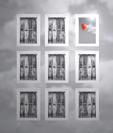 Fantasy shutters in a cloudy wall and one opened window with cloud and red balloon in black and white