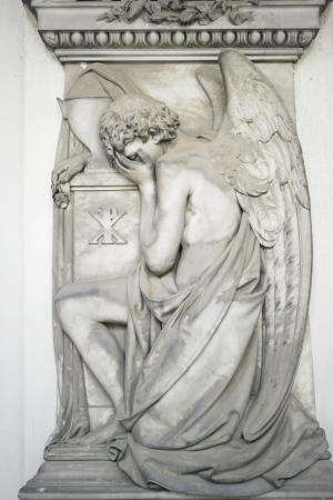 angel cemetery: Beautiful antique angel statue kneeling, Staglieno, Genoa