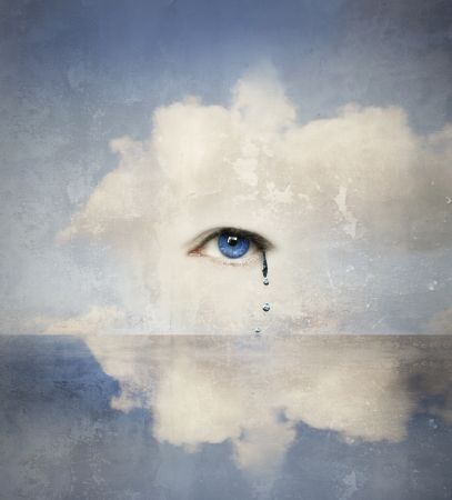 to cry: Fantasy concept of a human eye crying in the clouds  Stock Photo