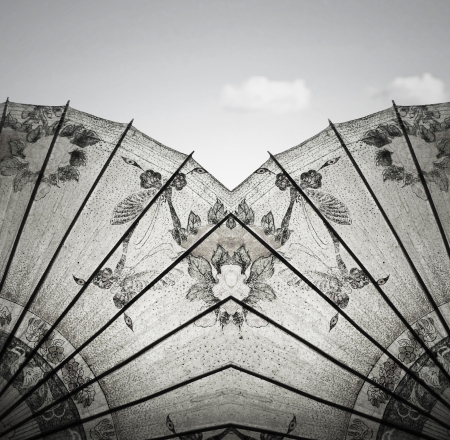 Detail of a beautiful vintage decorative rice paper chinese umbrella with sky and cloud in the background in black and white
