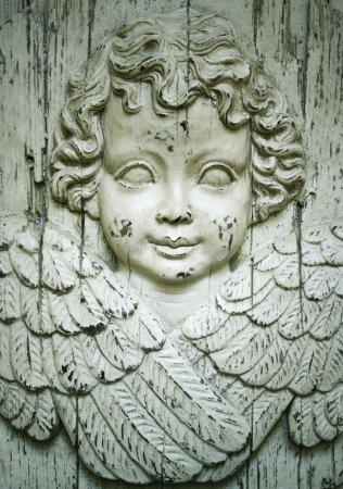 religious angel: Detail of a beautiful wooden sculpture representing a cherub angel