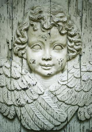 Detail of a beautiful wooden sculpture representing a cherub angel
