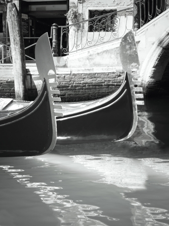 characteristic: Characteristic angle of Venice with a detail of two gondola on the water in black and white Stock Photo