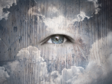 Fantasy concept of a blue light eye in the cloudy sky Stock Photo