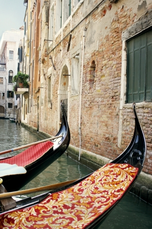 foreshortening: Foreshortening of buildings on a small canal in Venice, with detail of two gondola  Stock Photo
