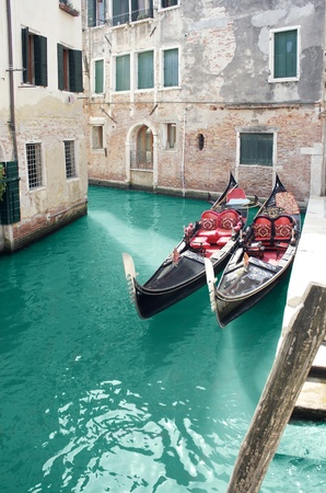 foreshortening: Beautiful foreshortening of buildings on a small canal in Venice, with detail of two gondola