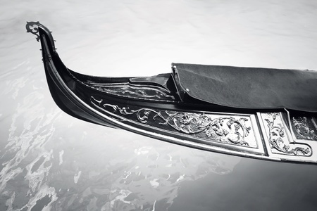 Detail of a gondola floating on the water in black and white photo