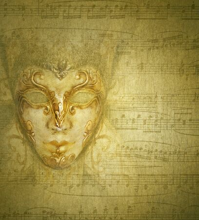elaboration: Beautiful vintage background golden mask with musical score in the background