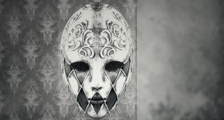 Beautiful Harlequin Venetian mask in black and white  photo