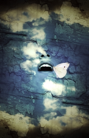 Fantasy surrealistic imagine of a human open mouth in the sky with a butterfly Stock Photo