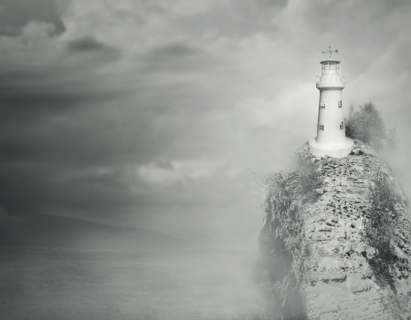 Beautiful fantasy background of a lighthouse on the top of a rocky mountain with sea and cloudy sky in black and white photo