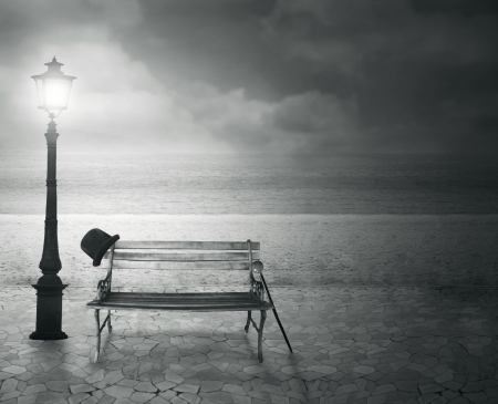 street lamp: Beautiful vintage artistic imagine at the sea at night in black and white Stock Photo