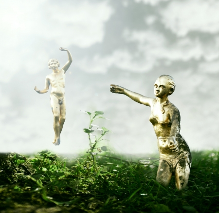 Beautiful fantasy background that represent two golden statues like Adam and Eve in the garden of Eden photo