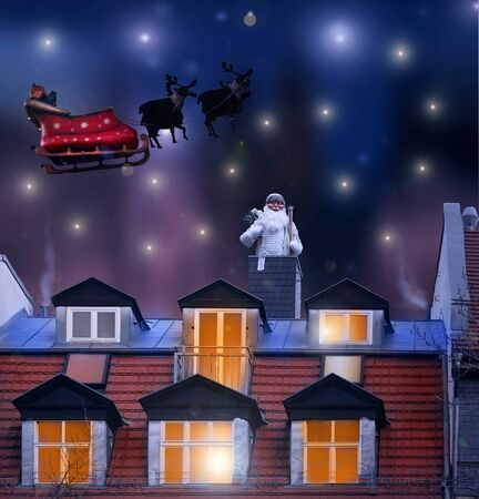 descends: Magical Christmas night background with Santa Claus descends the chimney on the roof