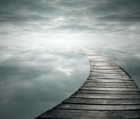Beautiful poetic background with a wooden footbridge into the infinity sky photo