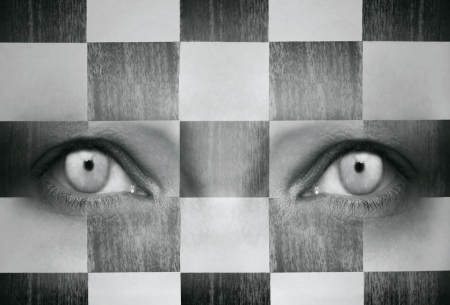 Human eyes with a chess texture in black and white Stock Photo - 17632355