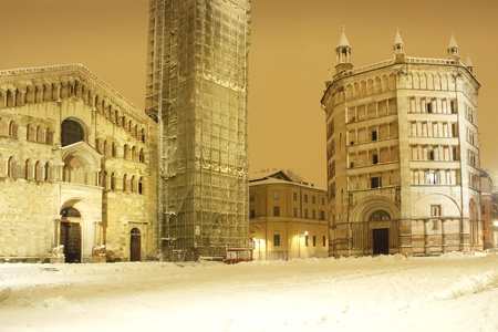 unique characteristics: Night shot with snow of the beautiful view of the Baptistery and Cathedral in Parma, Italy